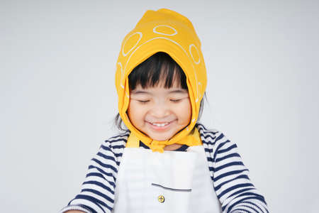 Portrait of cheerful pretty asian thai kid wearing yellow bandage smile with happiness isolate on white. 免版税图像