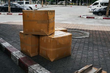 Cardboard boxes waiting for transport to customer at bus terminal.