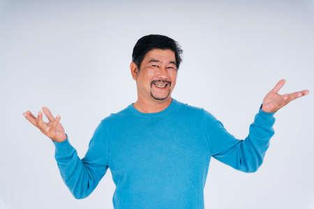 Portrait of old elderly senior man in blue long sleeve shirt showing two hands gesture.