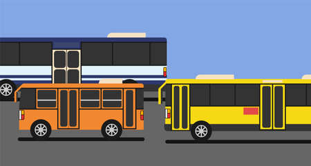 Yellow bus, blue and white bus and orange minibus drive on the road with blue sky and copy space.
