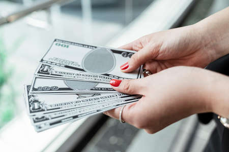 Bunch of banknote counting money cash. Woman hand holding cash.