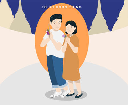 Young couple go to the templee in Buddhist Holy Day to do the religious activity by walking around the temple.