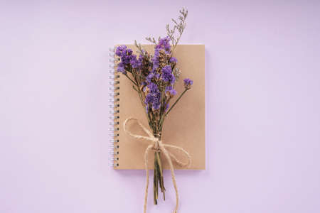 Purple flower lavender with brown book for mock up over purple pink background. Thai mother day.