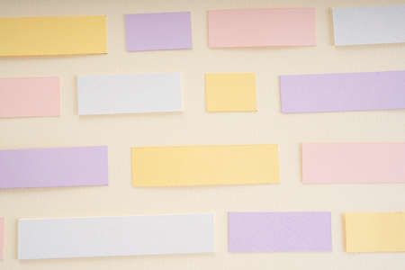Pastel purple pink yellow mock up sticky note over white background. Copy space.