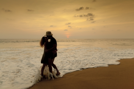romantic couple on the beach, kissing on the beach photo