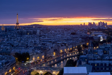 invalides: Aerial view of Paris at night with Eiffel Tower Editorial