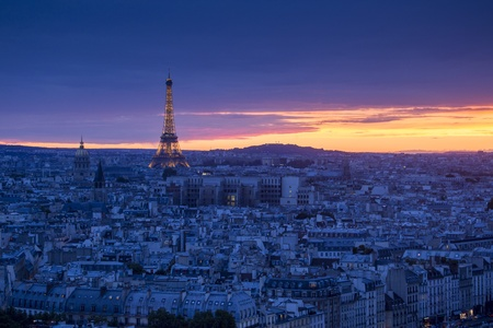 Aerial view of Paris at night with Eiffel Tower