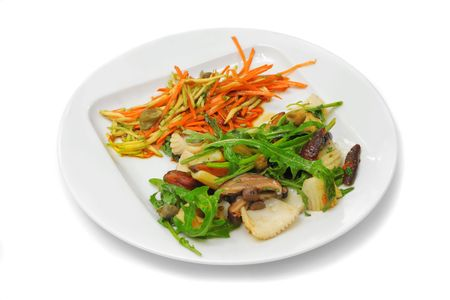 Octopus with mushrooms, orange carrot and green seaweed on the white plate Stock Photo - 4722392