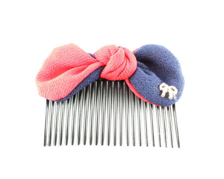 Hair brush with red and blue ribbon