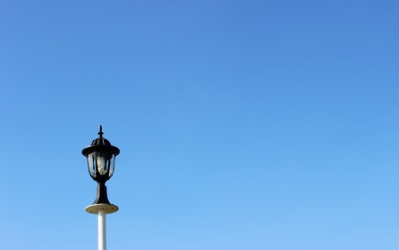 Lantern on a blue sky background photo