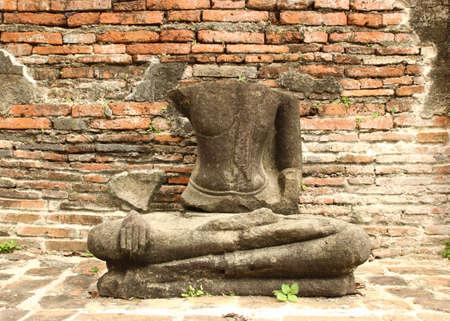 damage buddha statue in wat mahathat temple, Ayutthaya. Thailand (Public place)
