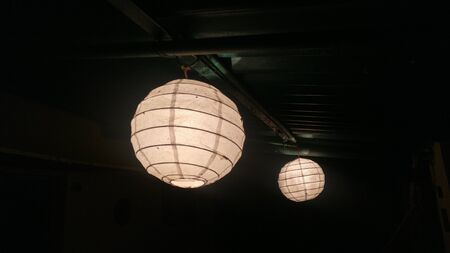 Round Beige Hanging Lights From Roof