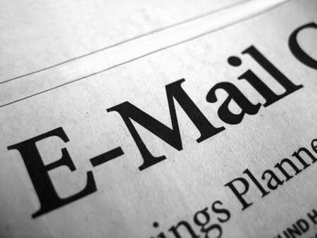 e ink: The word e-mail isolated from a newspaper headline. Stock Photo