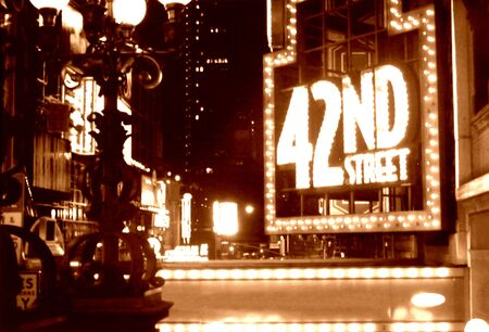 out in town: 42nd street  times square NYC sepia
