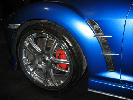 gunmetal: A closeup of the front quarter of a blue import sportscar. Stock Photo