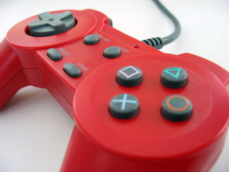 playstation: a red video game controller isolated over white