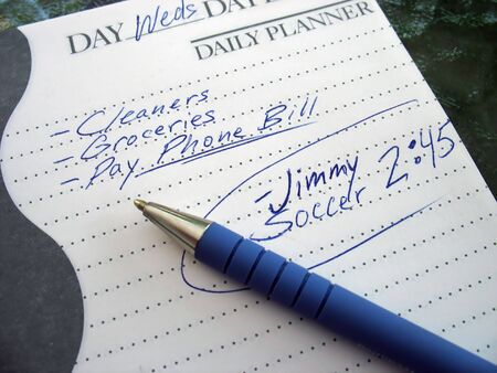 hectic life: a very busy schedule - written out on a daily planner Stock Photo