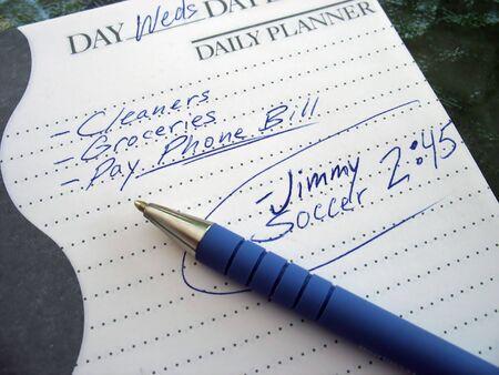 een zeer drukke agenda - geschreven op een dagelijkse planner