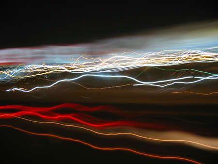 Abstract light trails from cars, signs, and other landmarks. Stock Photo - 2320786