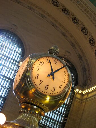 The old clock in the center of grand central station in New York City. photo