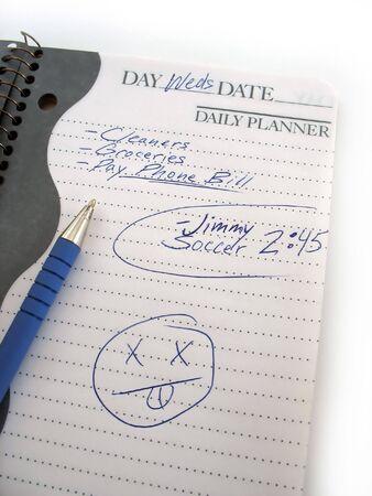 calendario escolar: Un ocupado horario diario de un libro moderno mam� o pap�.  Foto de archivo