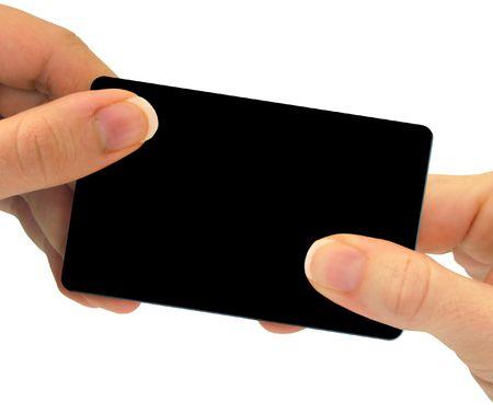 Twee handen te wisselen een blanco kaart - dit kan een visitekaartje, een cadeaubon, of zelfs een creditcard - gewoon om een paar verschillende opties. Gebruik je fantasie! Stockfoto