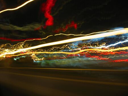 Abstract light trails captured from cars, signs, and other landmarks. photo