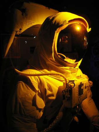 A complete astronaut setup under dramatic lighting.   photo
