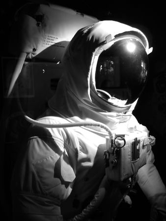 A complete astronaut setup under dramatic lighting.  Black and white.