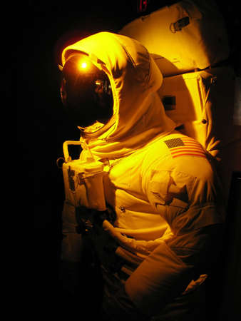 maneuvering: A complete astronaut setup under dramatic lighting.