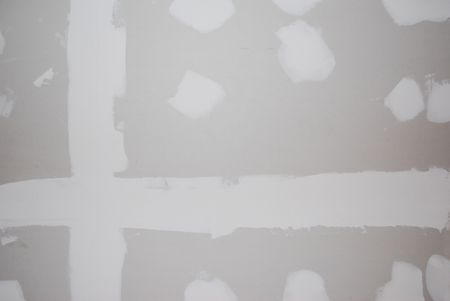 refinish: A sheetrock or drywall background.  The taping and spackling have been done in this shot. Stock Photo