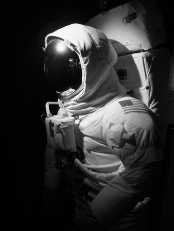 maneuvering: An astronaut set up under dramatic lighting - black and white.