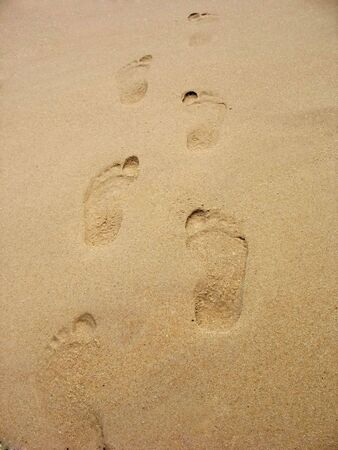 Footprints in the sand on the beach. This can be used for a wide range of concepts. Stock Photo