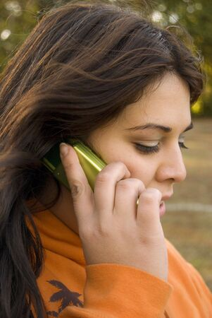 A beautiful young woman of latin descent talking on a cell phone Stock Photo - 2920337