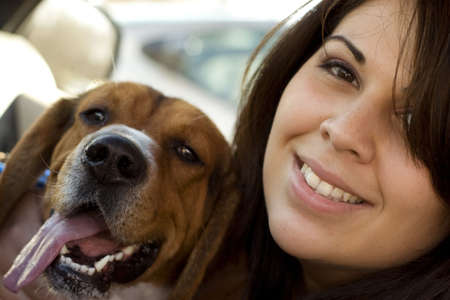 A portrait of a happy girl and her dog. Stock Photo - 2972722