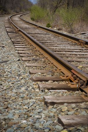 Railroad tracks curving off into the distance ahead. photo