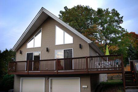 A newer, custom built, a-frame contemporary style house. photo
