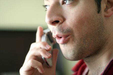 mouth close up: A man on his cell phone speaking excitedly or acting surprised about what he is hearing. Stock Photo