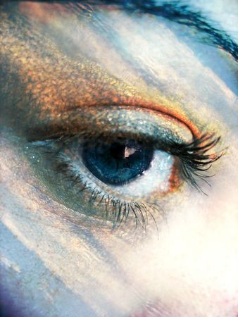 eyelids: A beautiful blue eye concept with the colors of the sky added.   Stock Photo