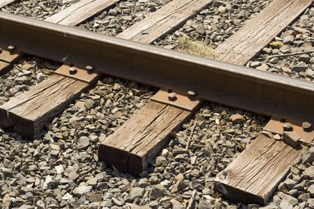 wood railway: A closeup of some weathered railroad tracks. Stock Photo