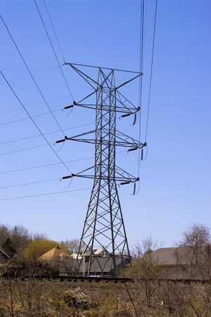 Some high power lines over a bright blue sky. Stock Photo - 3098393
