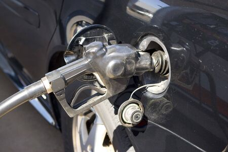 At the gas pump - filling up the tank. Stock Photo - 3106059