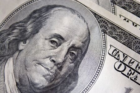 A closeup of the new 100 dollar bill picturing Benjamin Franklin.  Its all about the Benjamins. photo