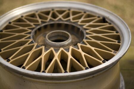 A custom gold rim with polished silver lip - tire removed.  Shallow depth of field. Stock Photo - 3129365