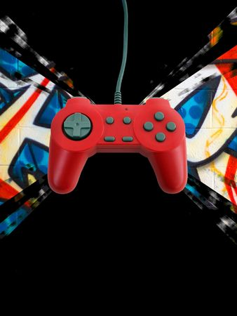 A red game controller over a graffiti background with plenty of copy space.  This file includes the clipping path.   Фото со стока