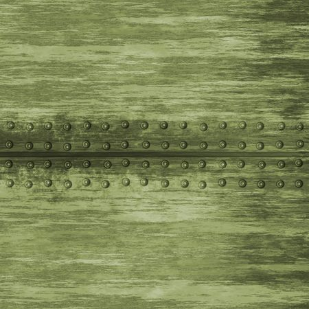 Grungy metal plate background with rivets.  This tiles seamlessly as a pattern. photo