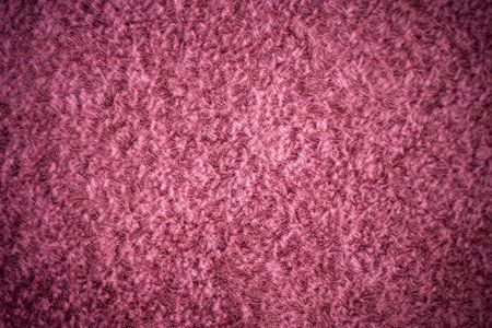 A pink shag carpet texture with added vignetting. photo
