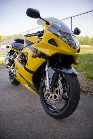 A brand new yellow motorcycle - modern day crotch rocket.  Stock Photo - 3174481