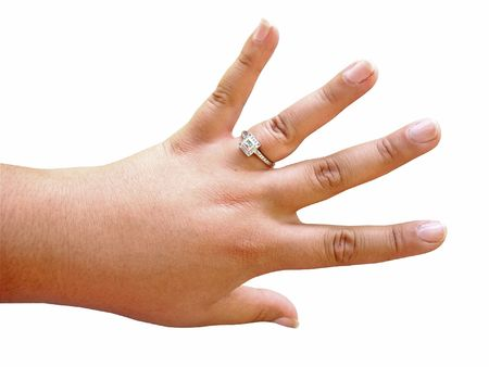 A  proudly showing off her custom made engagement ring - isolated over white.  Image includes clipping path.