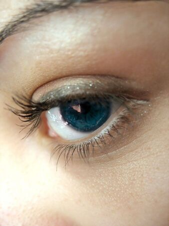 A macro shot of a pretty womans blue eye and lashes - shallow depth of field. photo